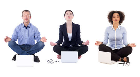 business people sitting in yoga pose with laptops isolated on white background Stock Photo