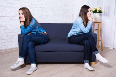 friendship and conflict concept - two sad girls after quarrel Banco de Imagens
