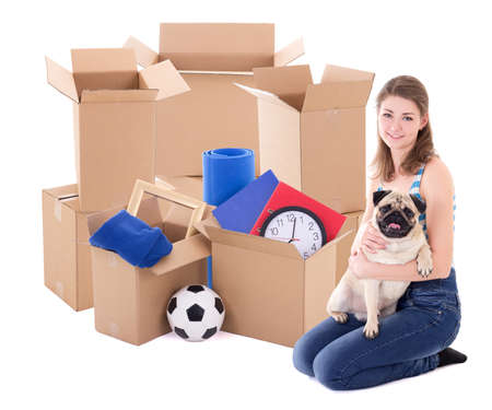 young woman with brown cardboard boxes and dog isolated on white background Stock Photo