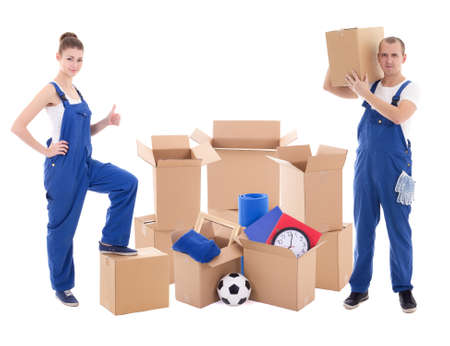 moving day concept - man and woman in blue workwear with cardboard boxes isolated on white background