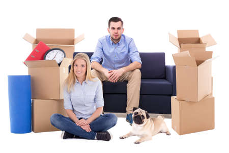 young couple with dog ready for moving day isolated on white background Stock Photo