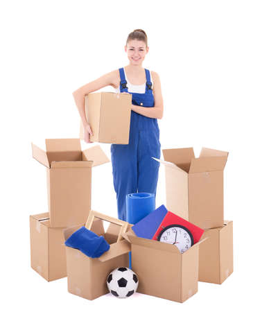 moving day concept - young woman in workwear with cardboard boxes isolated on white background Stock Photo