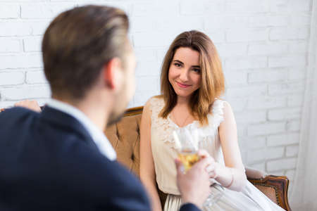 luxury apartment: portrait of happy couple drinking champagne at restaurant