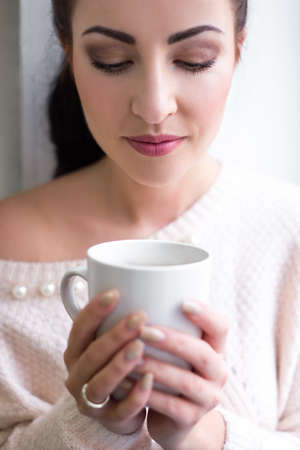 morning concept - cup of coffee or tea in female hands photo