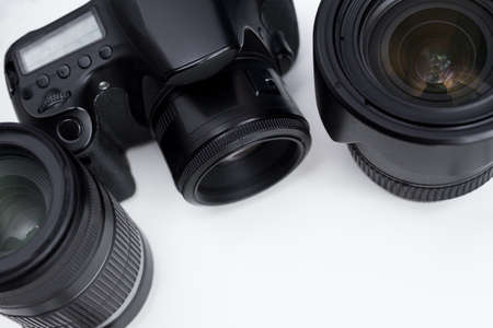 close up of dslr camera and lenses over white background