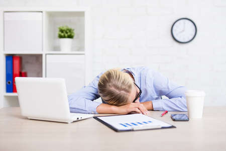 tired young business woman sleeping in office Stockfoto