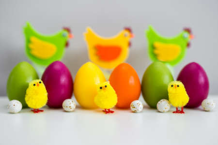 Easter background - close up of colorful Easter eggs and decorations on the table