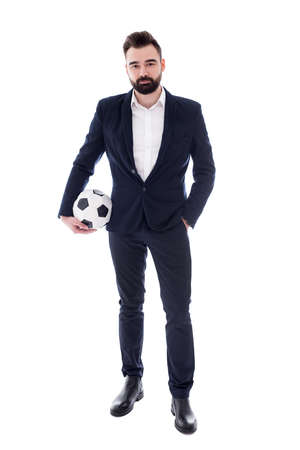 full length portrait of young handsome bearded businessman with soccer ball isolated on white background