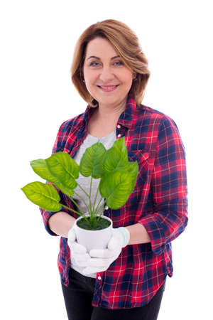 portrait of happy mature woman with potted plant isolated on white background