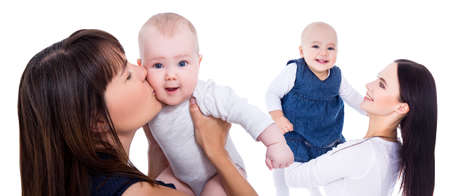 portrait of happy young mothers playing with little daughters isolated on white background