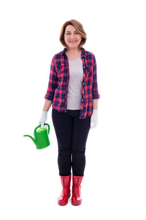 full length portrait of smiling middle aged woman gardener with watering can isolated on white background