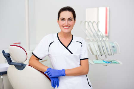 portrait of young female dentist posing in modern dental clinic Imagens