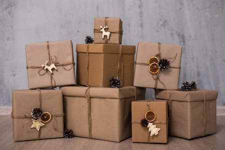 close up of gift boxes over gray wall background Zdjęcie Seryjne