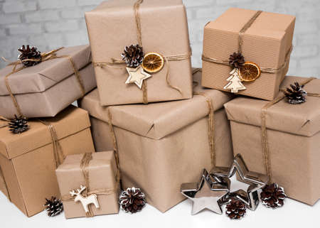 christmas and new year background - close up of beige gift boxes