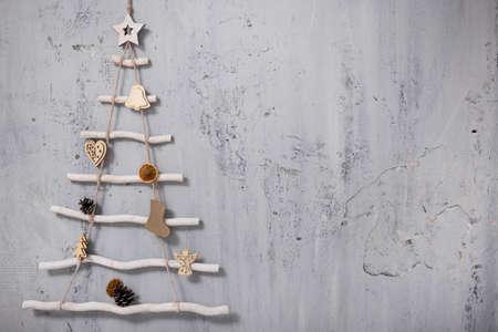 decorative christmas tree and copy space over grey concrete wall background Фото со стока