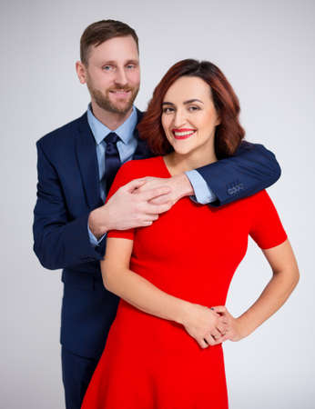 Valentines day concept - portrait of elegant couple posing over white background
