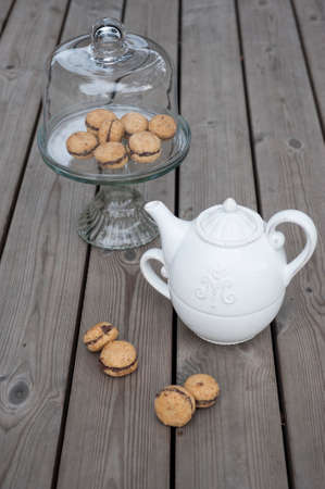 ceramic cake stand ladys kisses italian hazelnut sandwich cookies on cake stand with white
