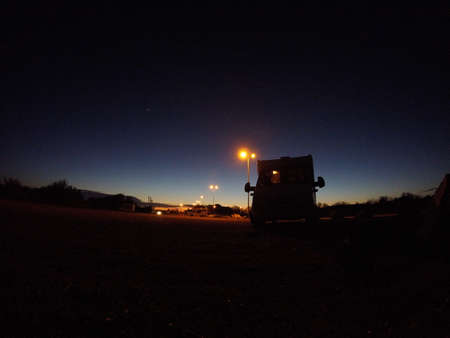 a lone camper parking area at sunset
