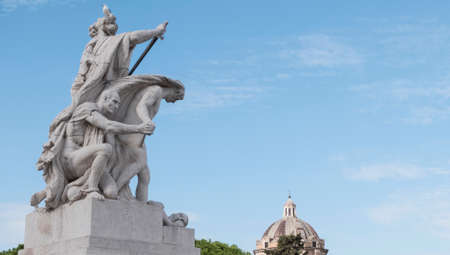 eclecticism: Campidoglio, Roma, Italy - Oct 23, 2016: Sculpture present within the Italian national monument called the altar of the homeland. In the background a beautiful blue sky with some clouds. Editorial