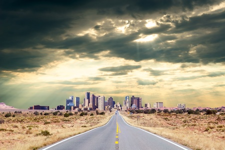 Road to the city through desert landscape Stock Photo - 10670806
