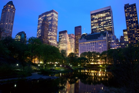 reflect: Central Park and New York City skyline at dusk, USA Stock Photo