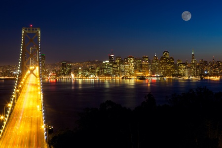 moon  metropolis: San Francisco skyline and Bay Bridge at night, California, USA Stock Photo