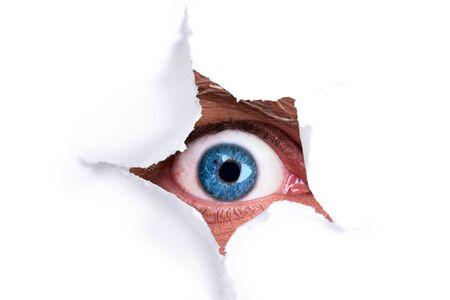 eye hole: Eye looking through a hole Stock Photo