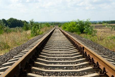 rail route: Railroad track vanishing into the horizon