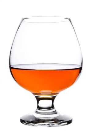 cognac: Snifter glass of cognac isolated on white