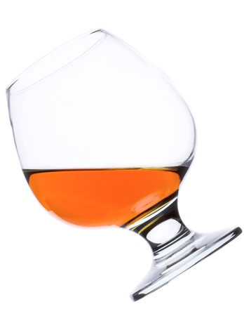snifter: Snifter glass of cognac isolated on white