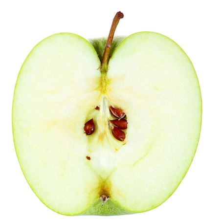 Green Apple cut in half isolated on white