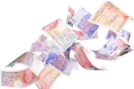 british money: Falling Pounds on a white background