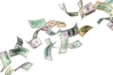 dinero volando: Volando de dólares en un fondo blanco Foto de archivo