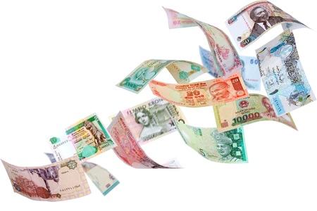 money flying: La caída de los billetes de diferentes países, aisladas sobre fondo blanco Foto de archivo