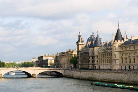 cite: Cite island view with Conciergerie and bridge Change. Paris