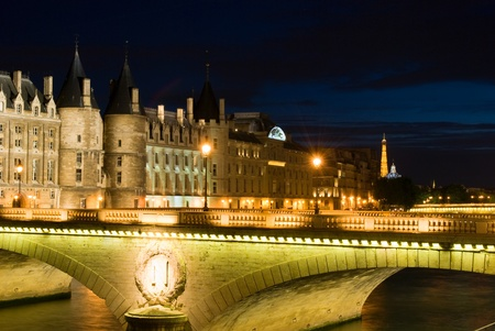 cite: Cite island with Conciergerie and Eiffel Tower. Night view.