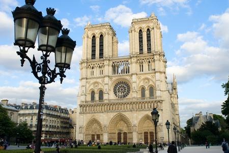 notre dame: Notre Dame de Paris, front view with street lamps. Stock Photo