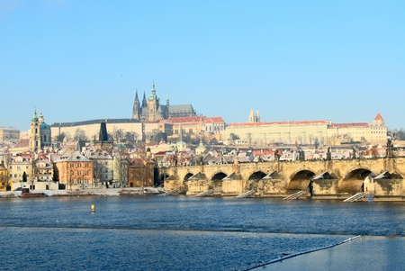 Prague castle and charles bridge in winter photo