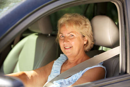 Senior woman at the wheel of her car photo
