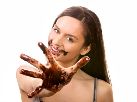 Happy young woman dirty in melted chocolate Stock Photo