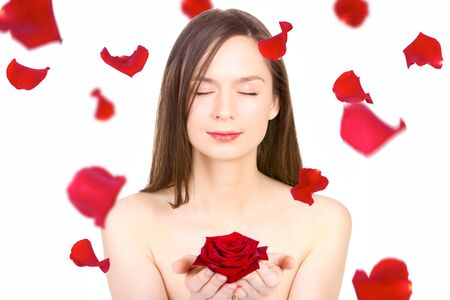 Beautiful woman with red rose in her palms isolated on white  photo