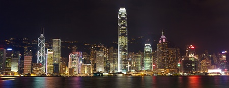 Hong Kong skyline at night over Victoria harbor photo