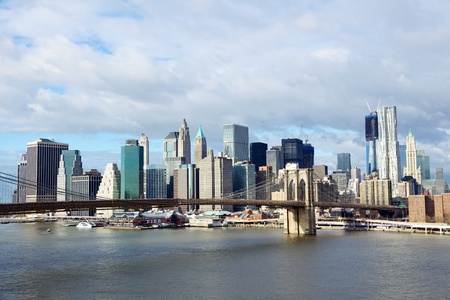 east river: Brooklyn Bridge with lower Manhattan skyline in the morning over East River in New York City