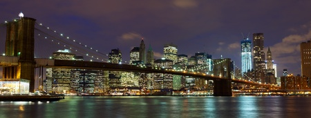 New York City Manhattan and Brooklyn Bridge at dusk  photo
