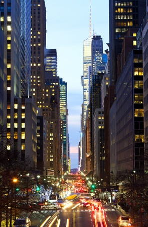 New York City Manhattan street view with busy traffic at dusk