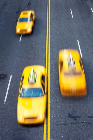 Yellow taxi cabs in motion in New York City photo