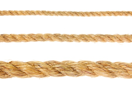 Different size ropes on white background photo