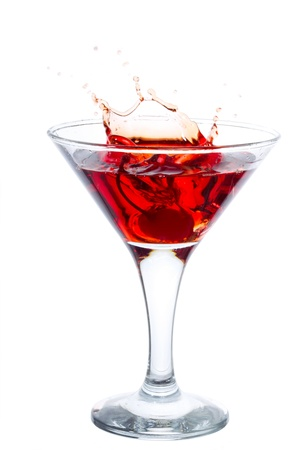 Cocktail with cherry splash isolated on white Stock Photo - 12525784