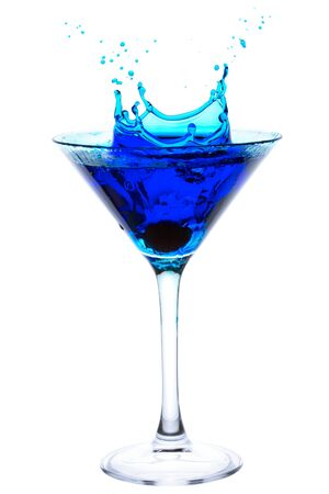 martini splash: Blue Cocktail with cherry splash isolated on white