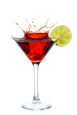 Cocktail with splash and lime slice isolated on white Stock Photo - 12525782